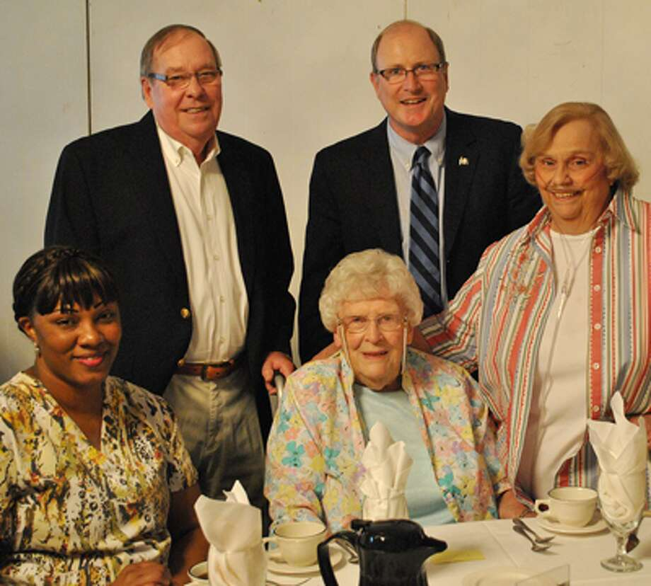 Lillian Emery, center, one of the original founders of the AARP Huntington Chapter who will celebrate her 100th birthday this summer, joined state Sen. Kevin Kelly and fellow AARP members at a recent luncheon and award ceremony. From left are Latoya Guman; Jim Kelly, outgoing president of the AARP Shelton Chapter; Lillian Emery; Sen. Kelly; and Susan Raiente.