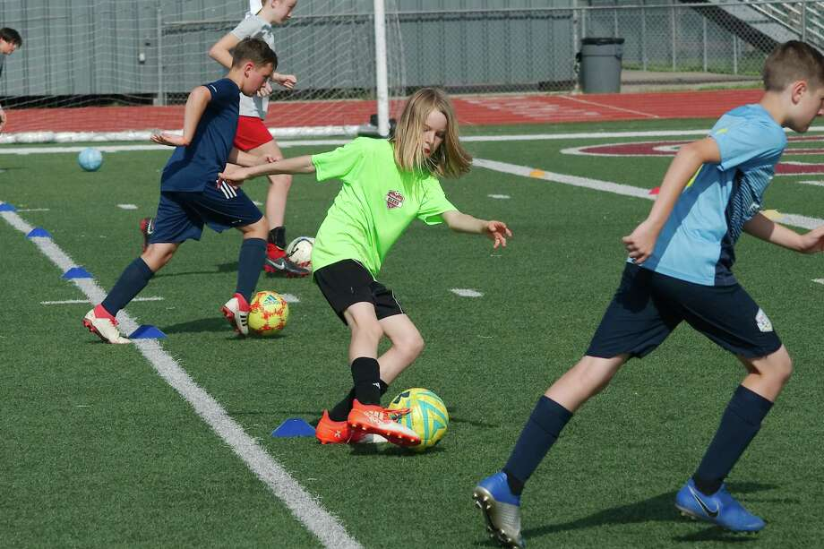 Taylor Schaefer (center) participates in a dribbling drill at the Pearland summer soccer camp at The Rig. Photo: Kirk Sides / Staff Photographer / © 2019 Kirk Sides / Houston Chronicle