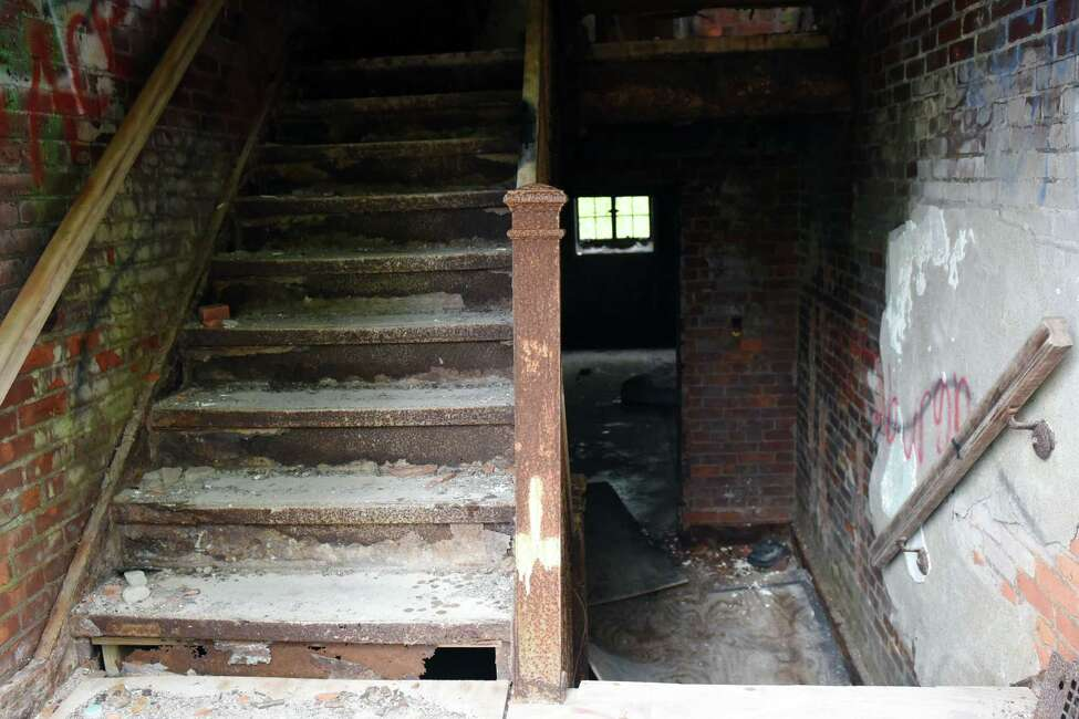 A stair case leading up to the first floor of the Homesteadsanatorium on Thursday, May 23, 2019 in Middle Grove, NY. (Phoebe Sheehan/Times Union)