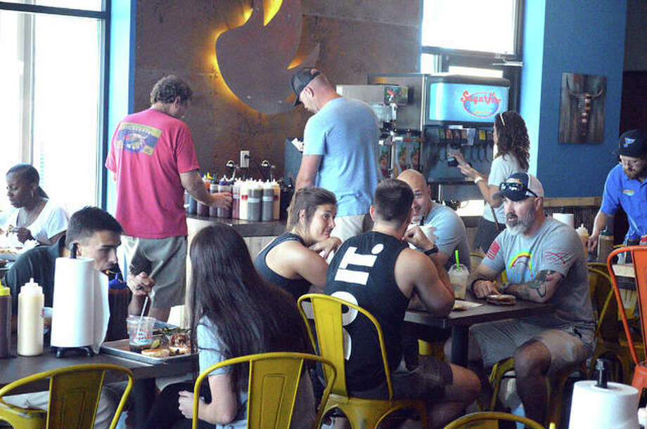 Sugarfire Smoke House was packed on Wednesday for the 11 a.m. grand opening of its new Edwardsville location at 2323 Plum St., Suite 100, in the newly constructed Ironworks plaza. Photo: Scott Marion   The Intelligencer