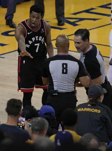 818d694fa65 <p>Toronto Raptors guard Kyle Lowry (7) gestures next to referees Marc