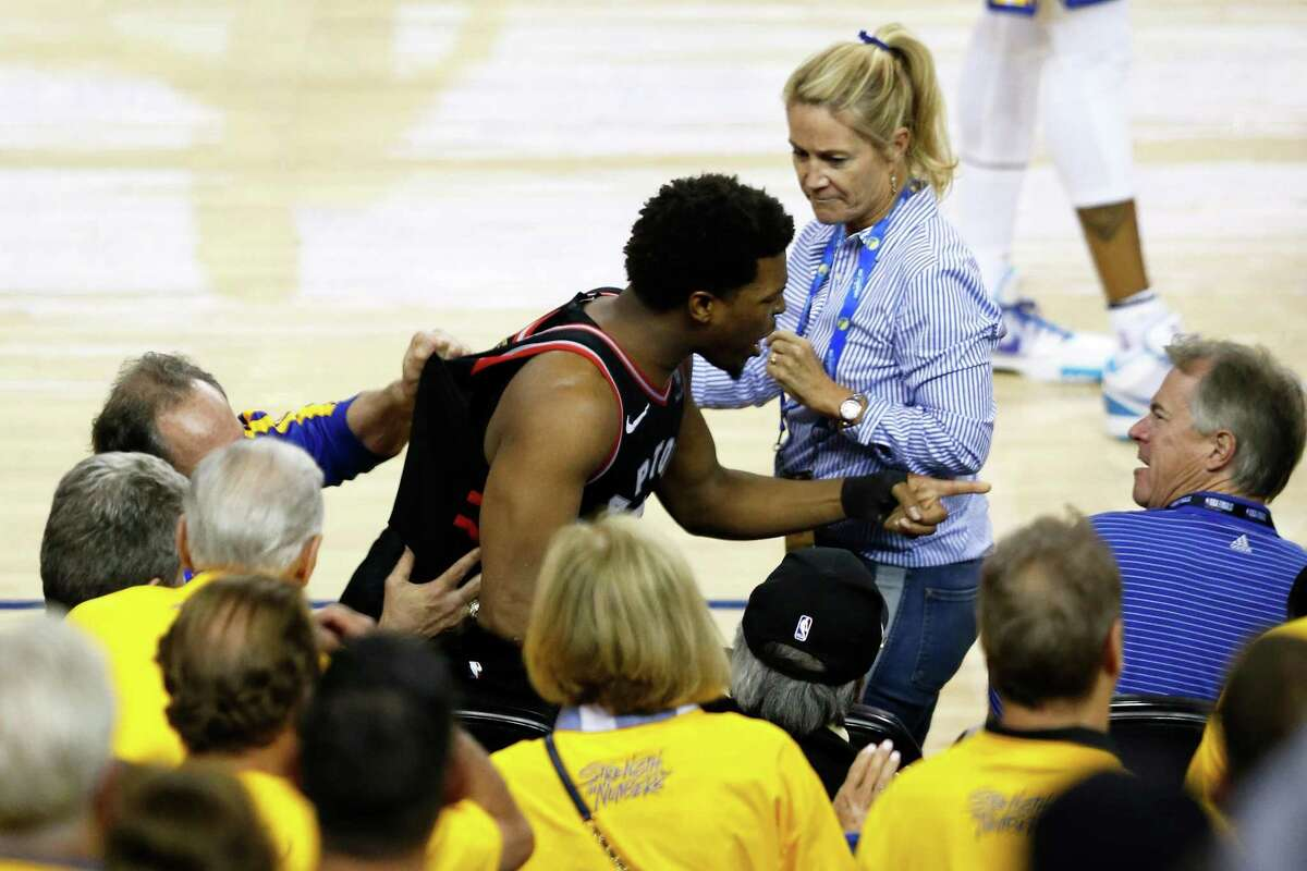 Kyle Lowry of the Toronto Raptors yells at Warriors minority owner Mark Stevens after Stevens shoved him in the shoulder. The incident happened after Lowry collided with two fans while going for a loose ball in the fourth quarter of Game 3 of the NBA Finals at Oracle Arena on Wednesday in Oakland.