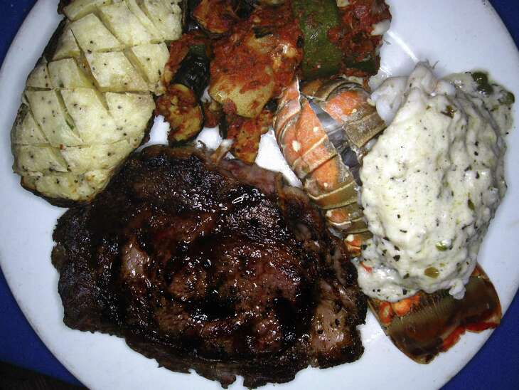 The Waiter's Special includes a grilled rib-eye, lobster tail with beurre blanc, squash gratin and a twice-baked potato at The Grey Moss Inn Restaurant.
