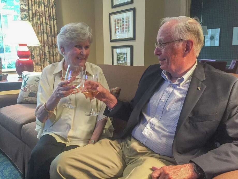 Margaret and Tom Gwynne toast each other to living at The Tradition. The couple originally resided in West University Place. Photo: Rebecca Hazen