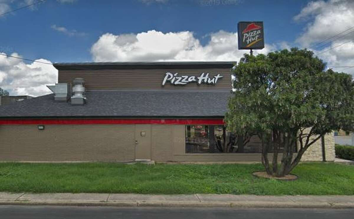 A 27-year-old man was arrested after allegedly robbing a South Side Pizza Hut with a paintbrush, San Antonio police said.