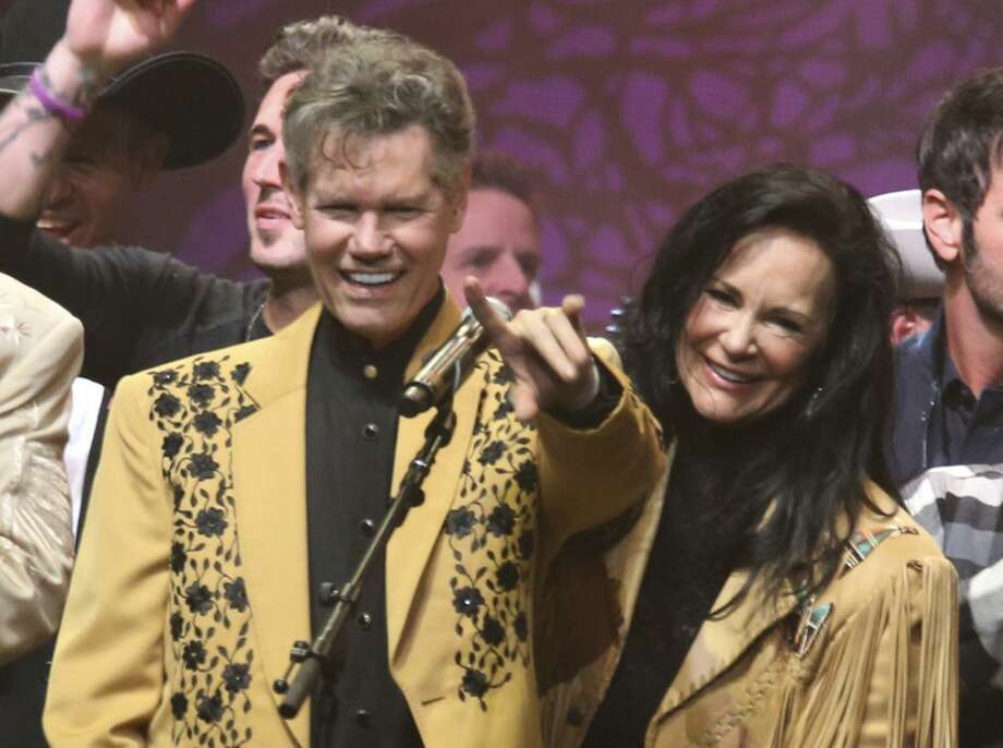 "FILE - This Feb. 8, 2017 file photo shows country singer Randy Travis, left, and his wife Mary Travis at the ""1 Night. 1 Place. 1 Time.: A Heroes and Friends Tribute to Randy Travis"" in Nashville, Tenn. Travis, who survived a near fatal stroke in 2013 that left him with a limited ability to speak, released his first memoir, ""Forever and Ever, Amen: A Memoir of Music, Faith and Braving the Storms of Life,"" chronicling his rise to fame. (Photo by Laura Roberts/Invision/AP, File) Photo: Laura Roberts, INVL / Associated Press / 2017 Invision"