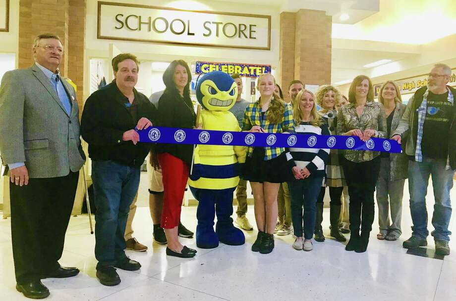 Members of the East Haven Chamber of Commerce, East Haven High School administration, and students celebrate grand opening of Buzzstop, the new student run cafe in the high school atrium. Photo: Contributed / Lisa Reisman