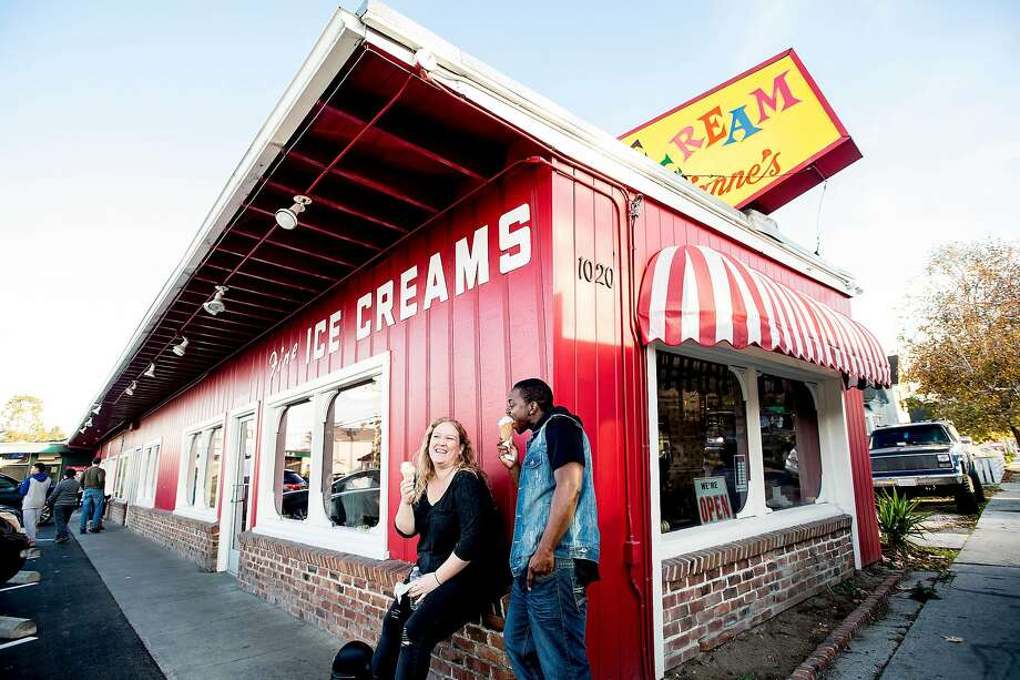 Lauren Bower and Javon Burke eat cones outside Marianne's Ice Cream in Santa Cruz in 2017. It's often too cold in San Francisco to eat ice cream. Photo: Noah Berger / Special To The Chronicle 2017