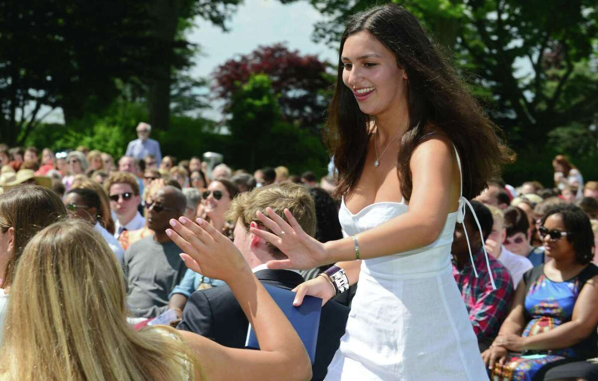 Westport resident Nicole Greenberg receives congratulations from classmates during The Greens Farms Academy 2019 Commencement Ceremonies on Thursday in Westport.