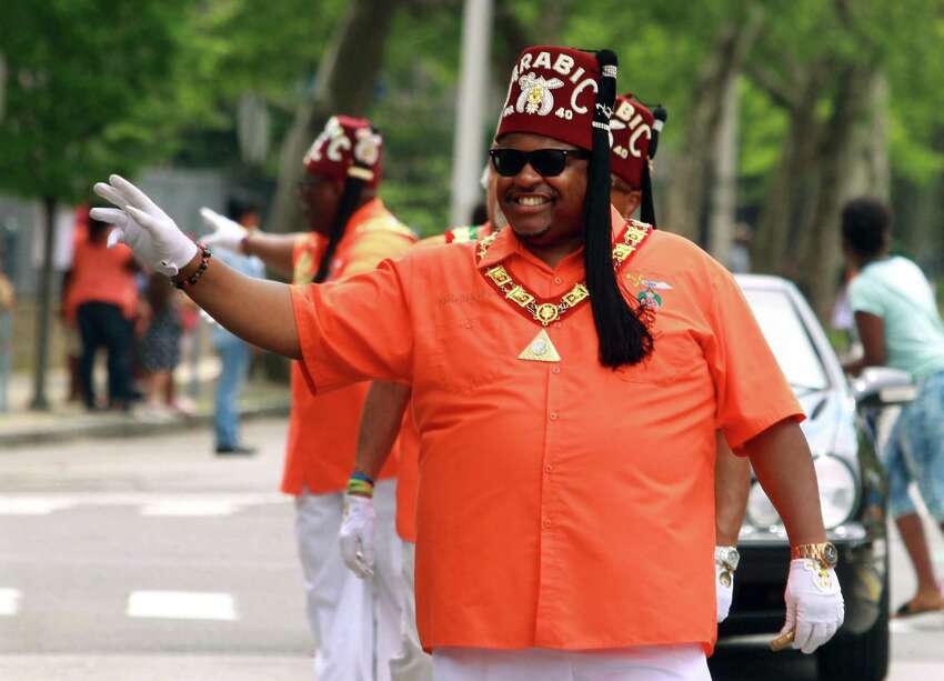 Richard Grey, a member of the Arabic Temple 40 Shriners in New Haven, waves as he takes part in the annual Juneteenth African-American Caribean Parade and Festival in downtown Bridgeport, Conn. on Saturday June 9, 2018. New Haven Liberation Day March and Teach-In When: June 19, 3-8 p.m. Where: New Haven Green What: