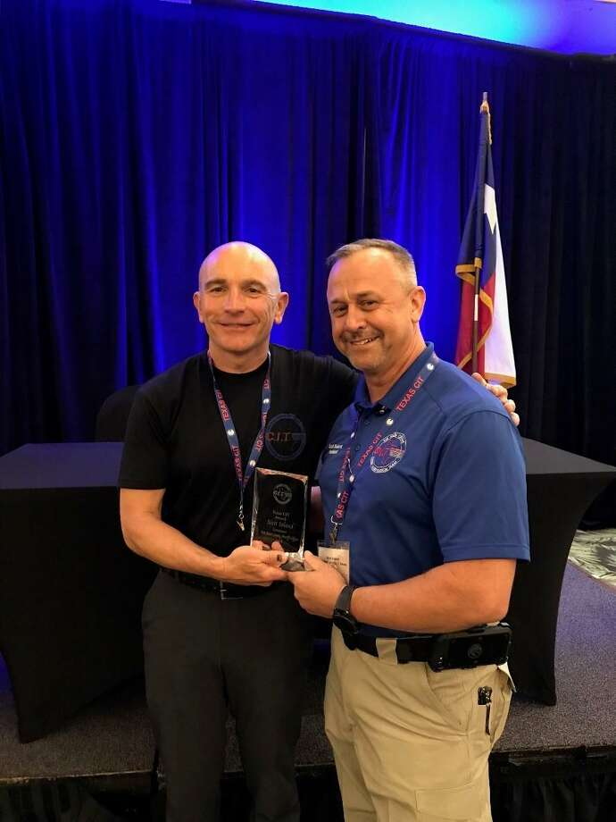 Sgt. A.D. Paul, of the Plano Police Department, with Fort Bend County Sheriff's Office Lt. Scott Soland, who received the Texas CIT Association Award. The award is presented to an association member who exhibited the most effort to make a positive impact on community mental health, across the state of Texas, and whose dedication to the association is exemplified in these efforts. Photo: Texas CIT Association