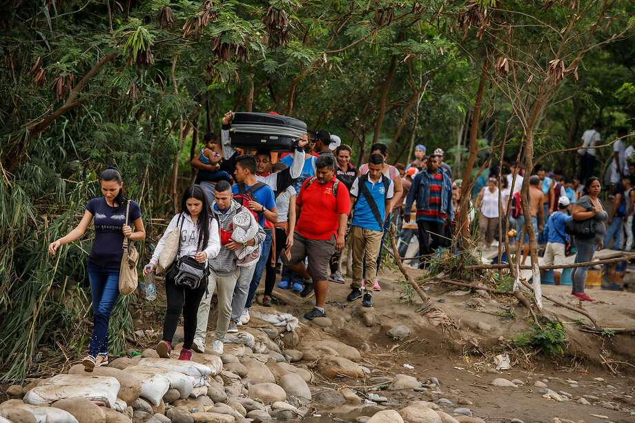 Venezuelans crossed the border into Colombia last month. Venezuela has overtaken China to become the No. 1 country of origin for those claiming asylum in the U.S. upon arrival. Photo: Marcus Yam / Tribune News Service