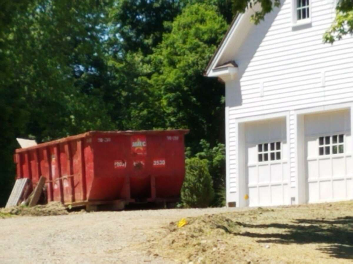 A Dumpster outside of a home on Sturbridge Hill Road in New Canaan. The property is being developed by Fotis Dulos' company, the Fore Group, and was the target of a state police search on Wednesday.