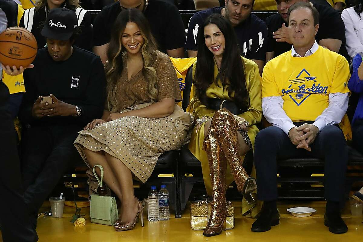 OAKLAND, CALIFORNIA - JUNE 05: (L-R) Jay-Z, Beyonce, Nicole Curran and Joseph S. Lacob attend Game Three of the 2019 NBA Finals between the Golden State Warriors and the Toronto Raptors at ORACLE Arena on June 05, 2019 in Oakland, California. NOTE TO USER: User expressly acknowledges and agrees that, by downloading and or using this photograph, User is consenting to the terms and conditions of the Getty Images License Agreement. (Photo by Ezra Shaw/Getty Images)