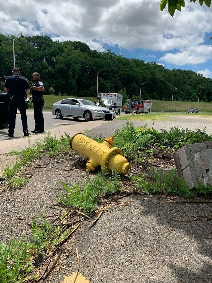 A motorist struck a fire hydrant earlier this afternoon, shearing it from its base and launching it 30 feet away. Photo: Courtesy Of The Ansonia Rescue And Medical Services Facebook Page.