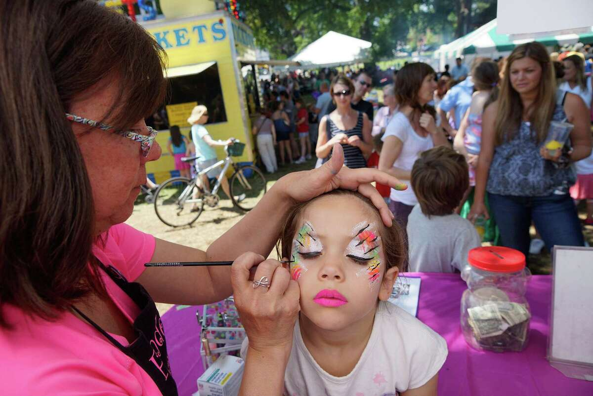 Isabella Jackowicz of East Haven gets her face painted by Eileen Cimino at the 29th annual Branford Festival in 2013.