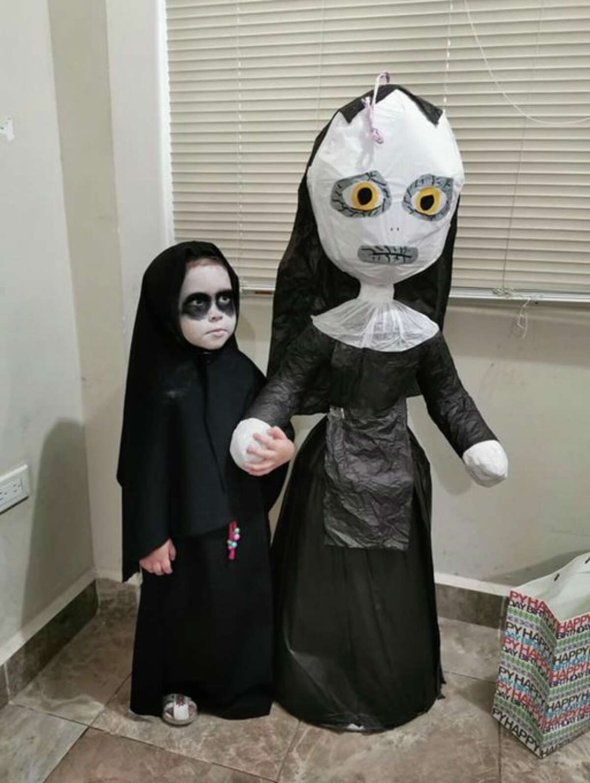 """Little Lucia celebrated her 3rd birthday in Monterrey, Mexico dressed as a tiny version of the demonic nun from """"The Nun"""" on Monday, her cousin Andrea Villarreal, a San Antonio resident, told mySA.com. Villarreal tweeted photos of the little girl in what has become an insanely popular post that even Jordan Peele noticed."""