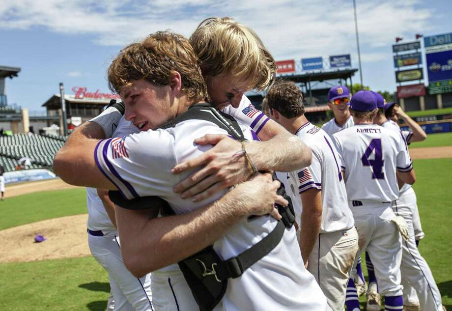 D'Hanis senior Alex Magers (27) hugs teammate catcher senior Jacob Hutto (21) after their win against New Hope at their 1A UIL baseball state championship game at the Dell Diamond on June 6, 2019 in Round Rock, Texas. Photo: Thao Nguyen, Contributor / Thao Nguyen