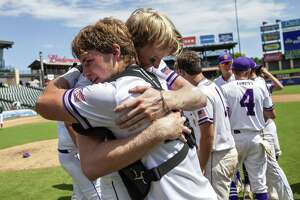 D'Hanis senior Alex Magers (27) hugs teammate catcher senior Jacob Hutto (21) after their win against New Hope at their 1A UIL baseball state championship game at the Dell Diamond on June 6, 2019 in Round Rock, Texas.
