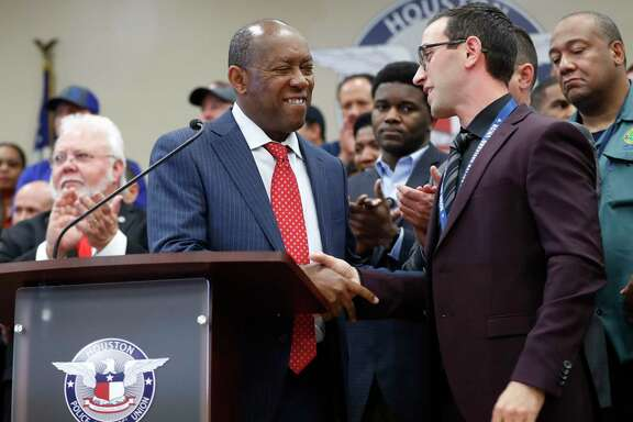 Mayor Sylvester Turner shakes hands with Joe Gamaldi, president of the Houston Police Officers' Union speaks to the media during a news conference, Wednesday, Jan. 31, 2018, in Houston, with the Mayor and council members on HPOU's drive to increase the city police force by 500 officers net during the next five years. ( Karen Warren / Houston Chronicle )