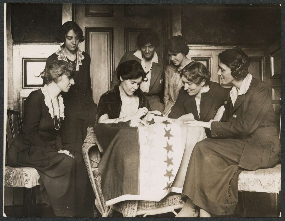 Members of the National Women's Party sewing a star into a flag symbolizing states that ratified the 19th Amendment (Library of Congress photo)
