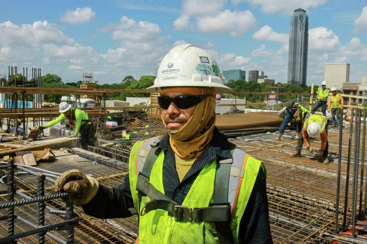 Elisandro Flores works on Park Place River Oaks at 4200 Westheimer, being built by Harvey Builders.