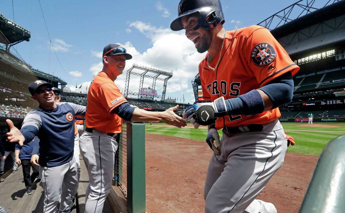 Houston Astros' Robinson Chirinos, right, smiles as he heads into the dugout after his two-run home run against the Seattle Mariners in the first inning of a baseball game Thursday, June 6, 2019, in Seattle. (AP Photo/Elaine Thompson)