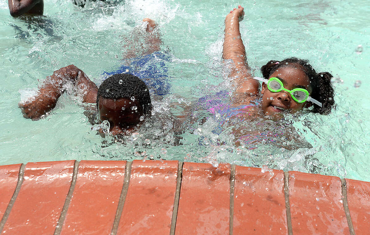 Jonrell Knatt and Aniyah Scott have a race to the edge as they enjoy cooling off on the opening day of Alice Keith Pool in South Park. The pool's oening was delayed due to a shortage of lifeguards, but the parks and recreation department worked last week to resolve the staffing issues and accommodate both of the city's pools, including Magnolia on the north end, to be open for the summer. Photo taken Thursday, June 6, 2019 Kim Brent/The Enterprise