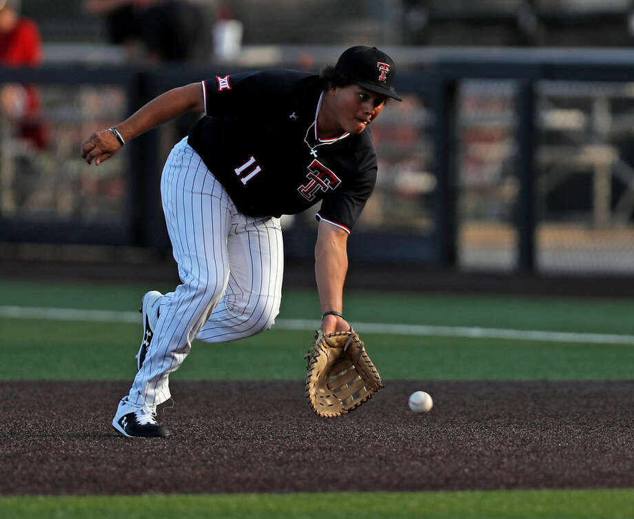 Texas Tech's Cameron Warren (11) fields a ground ball during the NCAA college baseball tournament regional game against Dallas Baptist, Sunday, June 2, 2019, in Lubbock. (Brad Tollefson/Lubbock Avalanche-Journal via AP) Photo: Brad Tollefson/Lubbock Avalanche-Journal Via AP
