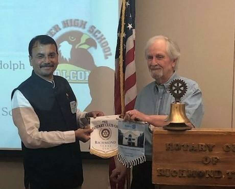 Rotary Club of Richmond was grateful to exchange flags with a fellow Rotarian from East Dombivil- India. From left are Madhav Chikodi and John Cotterell, president of the Rotary Club of Richmond. Photo: Rotary Club Of Richmond / Rotary Club Of Richmond