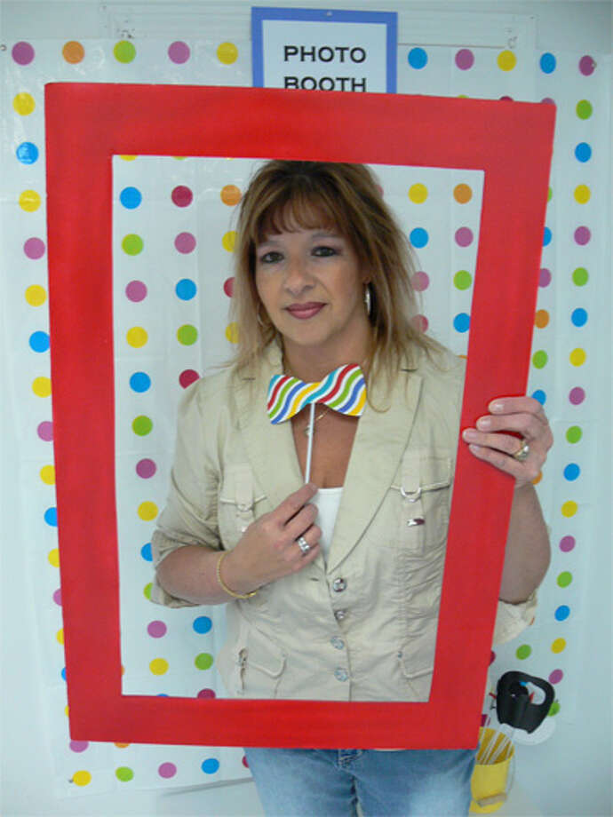 Owner Kim MacDougall in the photo booth area at her one-year-old Shelton business, Here's The Party!