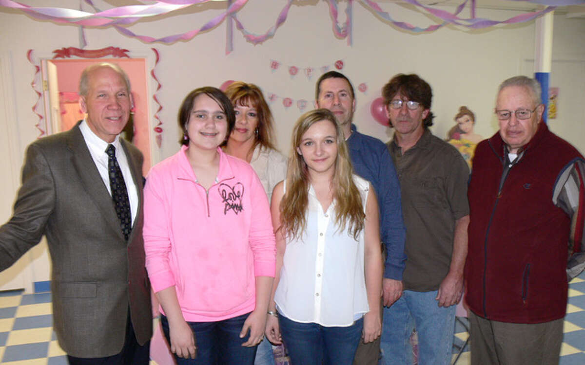 At the anniversary celebration for Here's The Party! are, from left, the chamber's Bill Purcell, family friend Megan Doyle, owner Kim MacDougall, daughter Elizabeth MacDougall, Alderman Eric McPherson, husband John MacDougall and Alderman John Anglace.