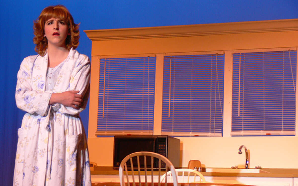 """Shelton High junior Alexandra Koumbaros as Vi Moore, the minister's wife, in the SHS production of """"Footloose, the Musical."""""""