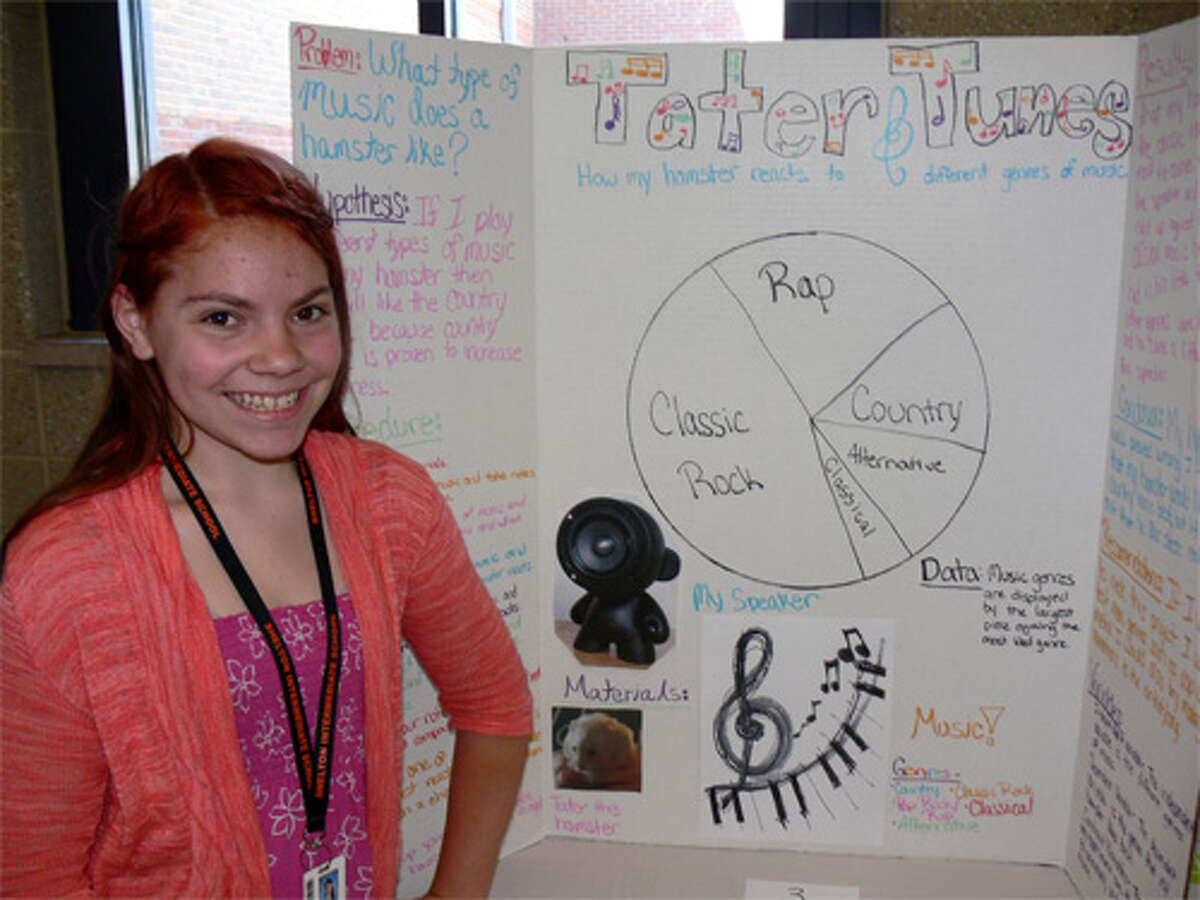 Amanda D'Amico stands in front of her project