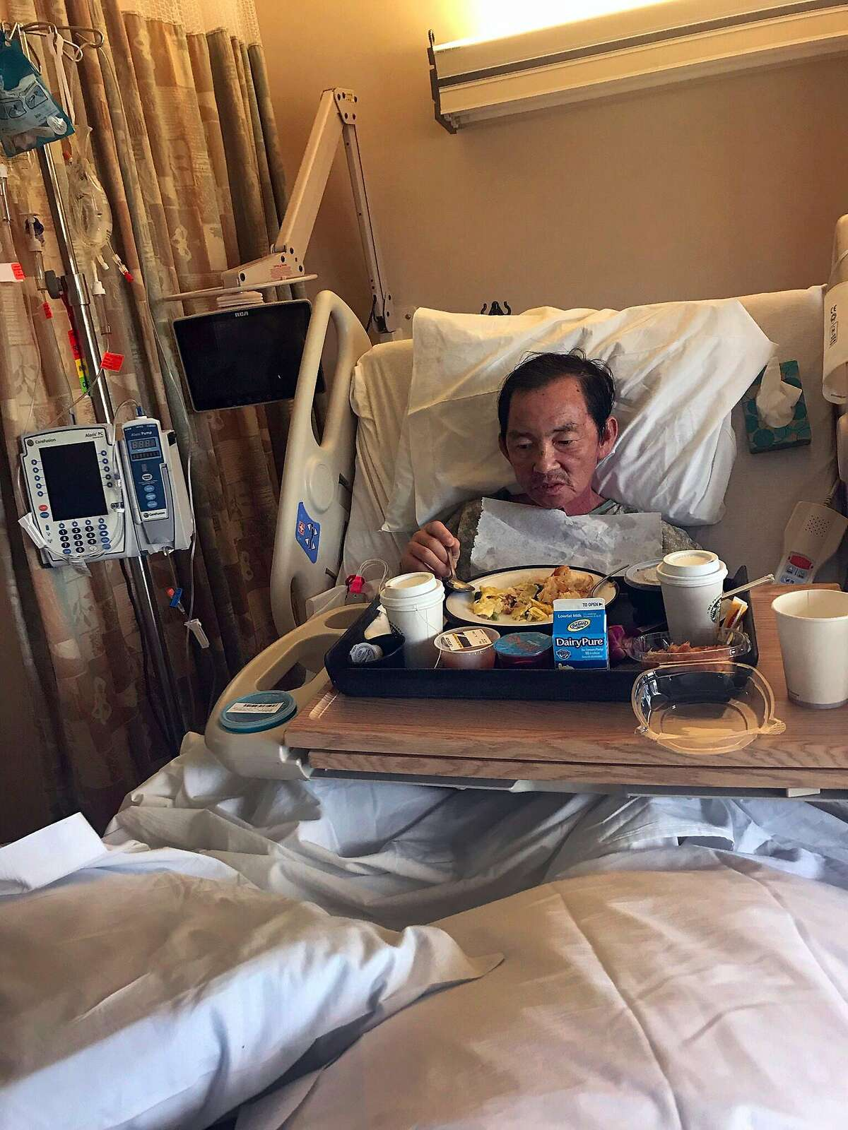 Tu Le of San Jose, is shown hospitalized at Good Samaritan Hospital in San Jose, Calif. on March 30, 2018. Le suffers from a rare form of cancer and a bone marrow transplant could save his life. His two brothers in Vietnam are matches to supply the marrow transplant but they have been denied entry visas to the United States.
