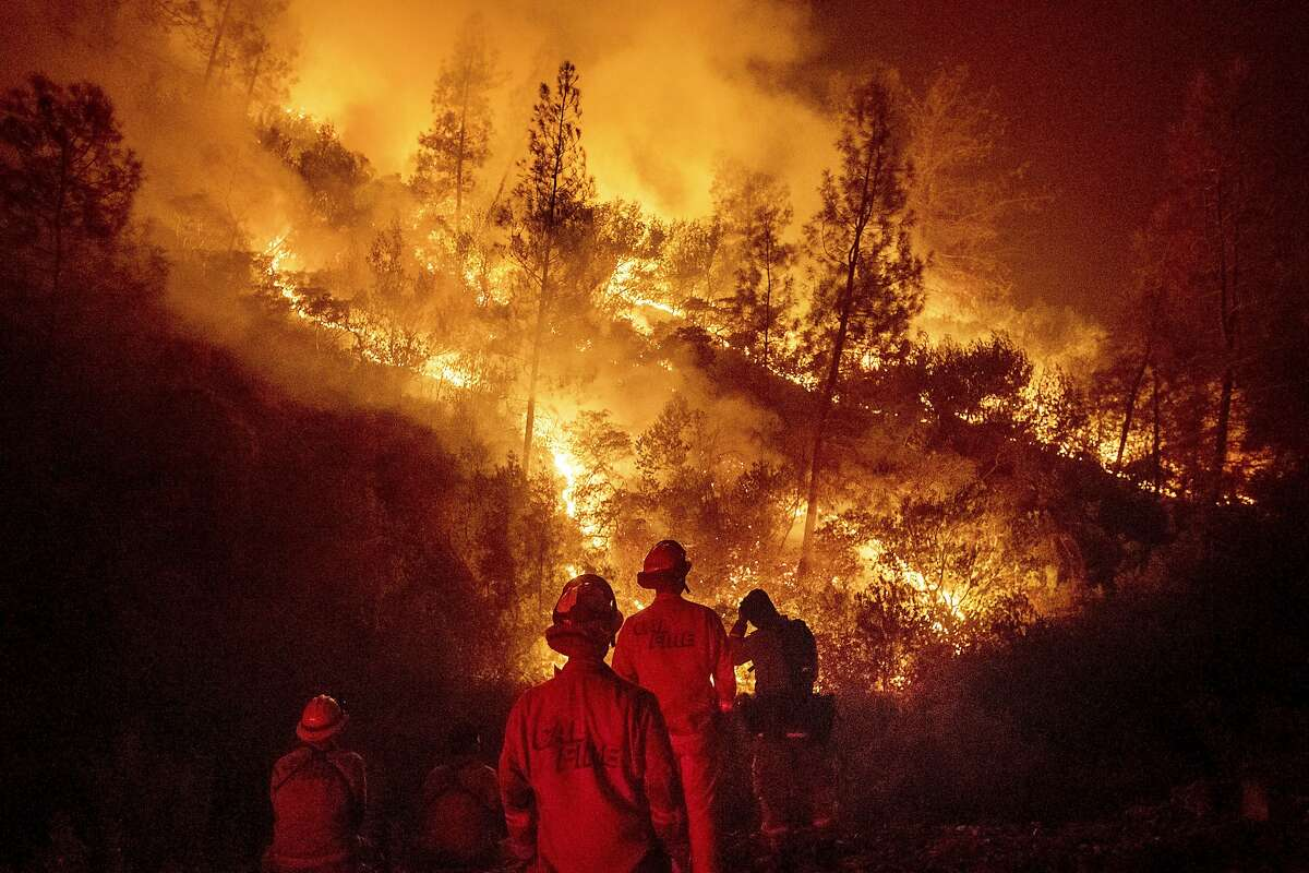 In this Aug. 7, 2018 file photo, firefighters monitor a backfire while battling the Ranch Fire, part of the Mendocino Complex Fire near Ladoga, Calif. The Mendocino Complex Fire was the largest in California history.