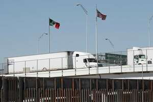 Tractor trailer trucks head into the United States from Mexico along the Bridge of the Americas on Tuesday in El Paso. President Donald Trump's threat to impose tariffs on Mexican goods hark back to the days when the U.S. protectionism helped plunge the world into chaos.