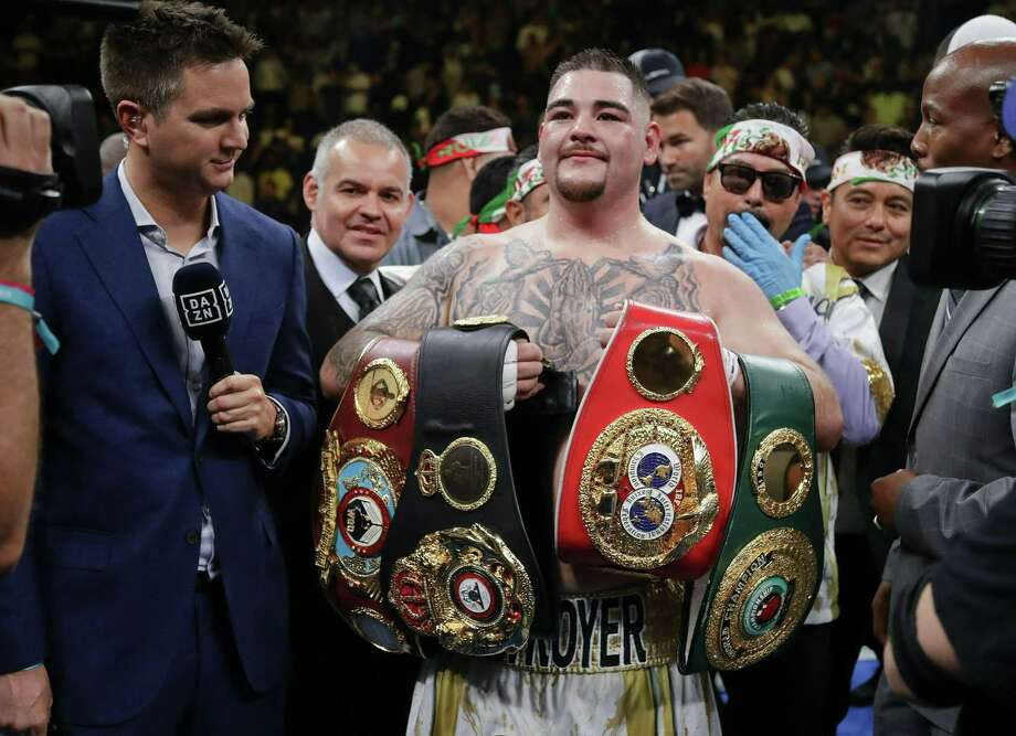Andy Ruiz poses with championship belts Saturday after defeating Anthony Joshua to capture the unified world heavyweight title. Ruiz has become a folk hero overnight among people of Mexican ancestry in the United States. Photo: Frank Franklin II /Associated Press / Copyright 2019 The Associated Press. All rights reserved.