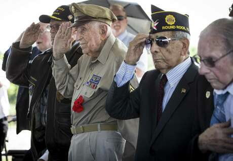 D-Day veterans, from left, Teddy Kirkpatrick, Achilles Kozakis and Robert Sanchez salute during a ceremony aboard the Battleship Texas on Thursday, June 6, 2019, in La Porte. The U.S.S. Texas was part of the D-Day operations in Normandy and is the last remaining battleship to have served during the invasion. The veterans were all awarded the French Legion of Honor for their service in the liberation of France.