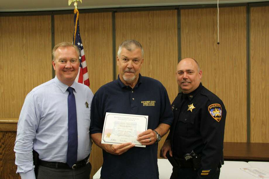 Sheriff Rand Henderson, left, and Steve Squier, right, present Montgomery County Sheriff's Office Citizen's Academy graduate David Shealy with a diploma. Photo: Courtesy Of The Montgomery County Sheriff's Office