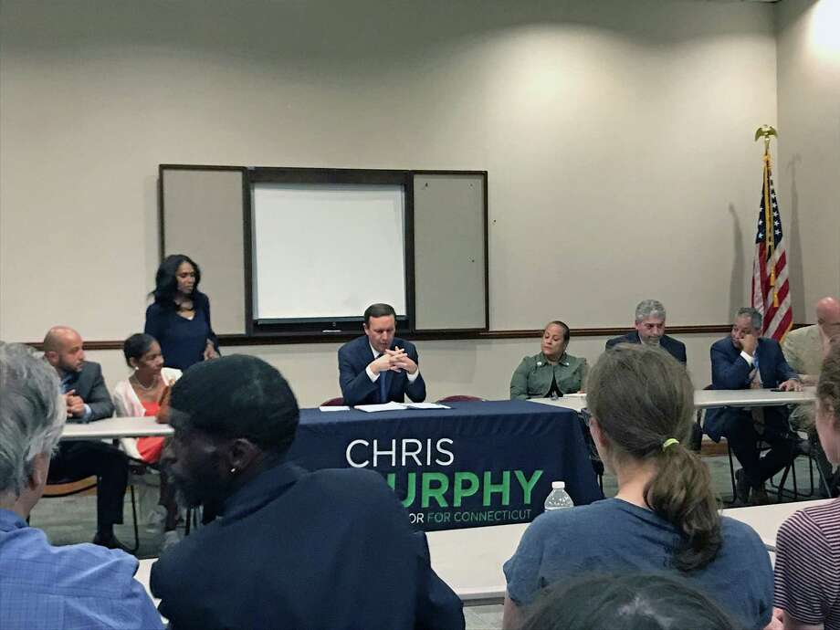 State Sen. Chris Murphy talks with local residents about the $19.1 billion Disaster Relief Bill, which will provide help to Puerto Rico, still recovering from Hurricane Maria in 2017. Photo: Hearst Connecticut Media / Tara O'Neill