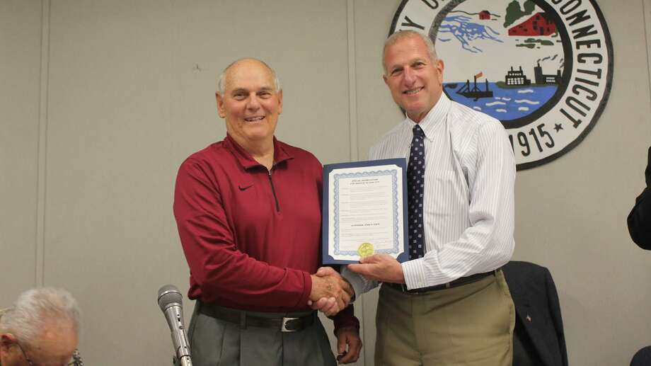 Mayor Lauretti presents John Papa with his award for his service over the past 22 years. - Aaron Berkowitz photo
