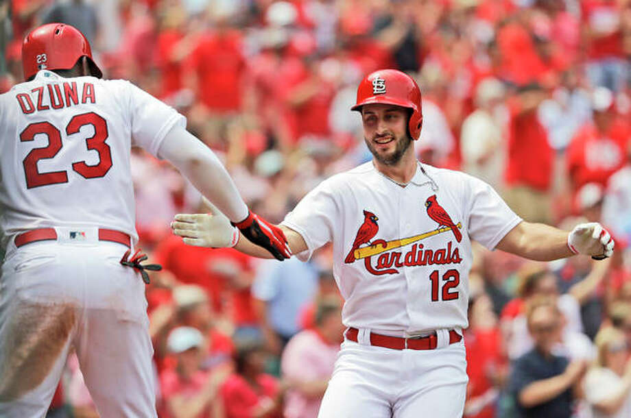 The Cardinals' Paul DeJong (12) is congratulated by teammate Marcell Ozuna after hitting a two-run home run during the seventh inning the Cincinnati Reds on Thursday at Busch Stadium. Photo: Associated Press
