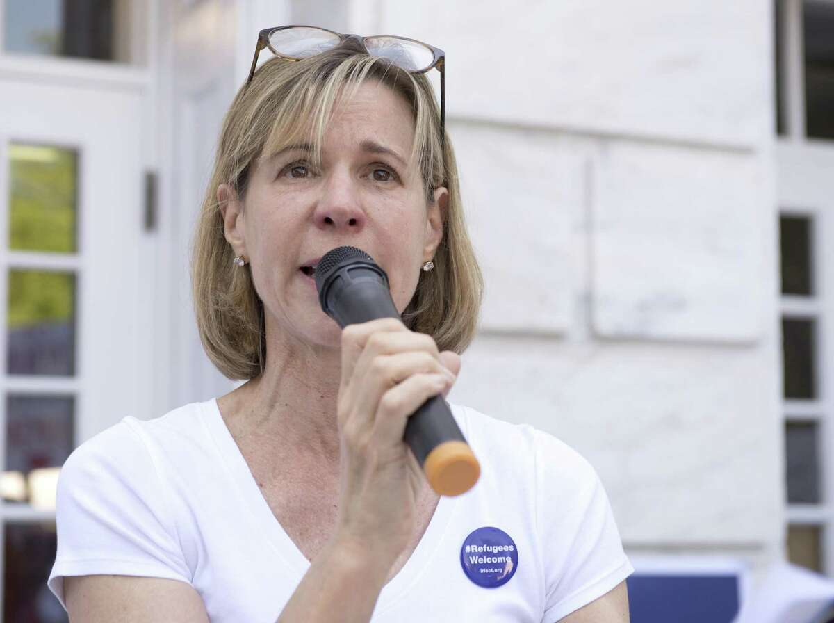 Joanna Swomley, Founder of Indivisible Greenwich, speaks during a rally at Greenwich Town Hall, in 2018. A complaint against Indivisible by the state Republican Party head was dismissed on Wednesday by the State Elections Enforcement Commission.