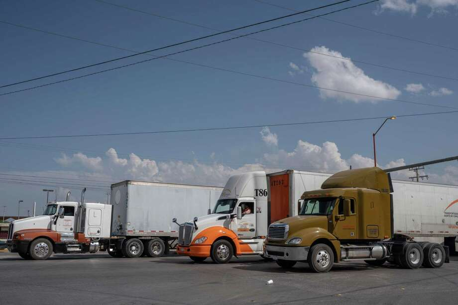 "(FILES) In this file photo taken on May 31, 2019 semi-trucks wait for inspection before crossing the border at the Zaragoza International Bridge, in Juarez, Mexico, across the border from El Paso, Texas. - Donald Trump stepped up his attacks on Mexico over immigration on June 2, 2019 as a top aide warned that the US president is ""deadly serious"" about slapping tariffs on imports from the southern neighbor. The attacks came despite efforts at conciliation by Mexico's President Andres Manuel Lopez Obrador, who said Saturday US officials were willing to ""reach agreements and compromises."" (Photo by Paul Ratje / AFP)PAUL RATJE/AFP/Getty Images Photo: PAUL RATJE, Contributor / AFP/Getty Images / AFP or licensors"