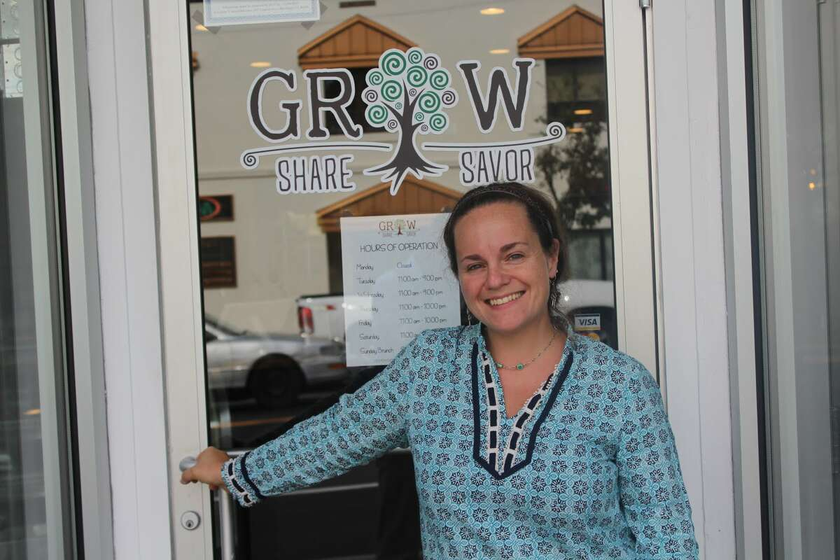Co-owner Michele Bialek stands out front of GROW restaurant on Howe Avenue, which opened in September of this year. - Aaron Berkowitz photo