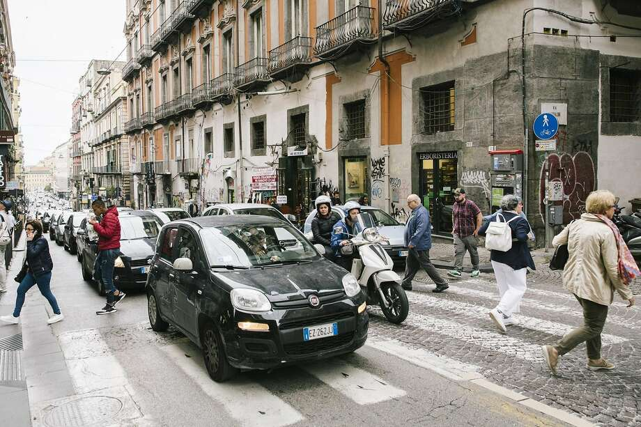A Fiat heads through the streets of Naples, Italy. The proposed merger of Fiat Chrysler Automobiles and Renault, a tie-up seen as a transformative deal in an industry facing challenges, fell apart last week. Photo: Gianni Cipriano / New York Times