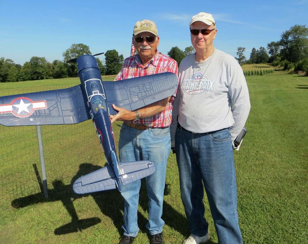 Club member John Nowell and Club event coordinator Andy Figlar get ready to fly a Corsair F4U. (Susan Hunter photo)