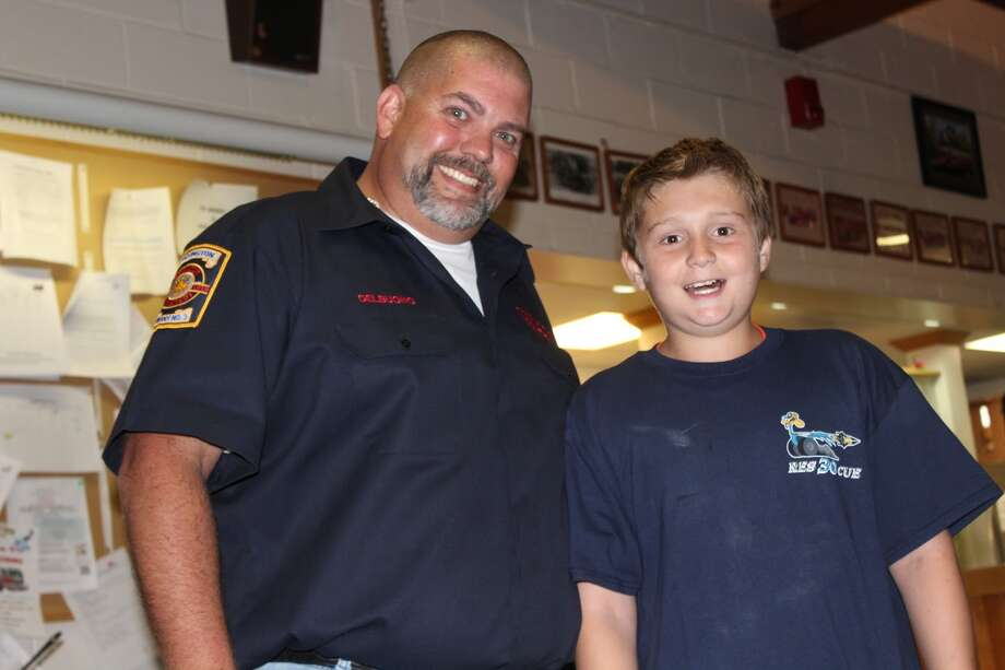 Vice President of Huntington Volunteer Fire Department Christopher Del Buono and Ray McPadden (Aaron Berkowitz photo)
