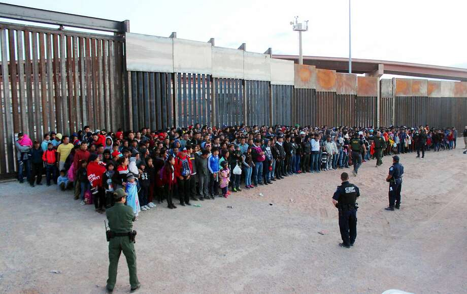FILE - This May 29, 2019 file photo released by U.S. Customs and Border Protection (CBP) shows some of 1,036 migrants who crossed the U.S.-Mexico border in El Paso, Texas, the largest that the Border Patrol says it has ever encountered. The federal government is opening a new mass shelter for migrant children near the U.S-Mexico border and is considering housing children on three military bases to add 3,000 more beds to the overtaxed system in the coming weeks. (U.S. Customs and Border Protection via AP, File) Photo: Associated Press
